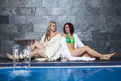 Women in wellness and spa swimming pool Royalty Free Stock Image
