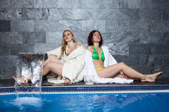 Women in wellness and spa swimming pool Royalty Free Stock Images