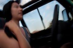 Women at the Wheel Motion Study Royalty Free Stock Photos