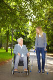 Women in wheelchair and on crutches Stock Photo