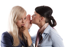 Women whisper Stock Photos
