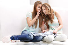 Women whisper Stock Photo