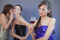 Women whispering on the party Stock Photography
