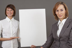 Women with white billboard Royalty Free Stock Image
