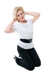 Women in white blouse and black trousers. Isolated on white background royalty free stock images