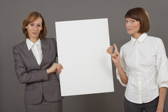 Women with white board Royalty Free Stock Photo