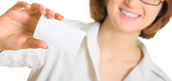 Women in white with a business card. Shallow DOF Royalty Free Stock Images
