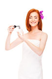 Women in white towel with perfume Stock Images