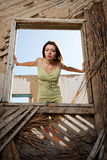 Women in the window. The girl is by the window and looks outside keeping for walls Royalty Free Stock Photo