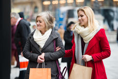 Women window shopping in centre of the city. Winter Royalty Free Stock Photo
