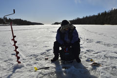 Women winter fishing on the ice Stock Photo