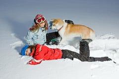 Women and winter fun with akita dog Stock Photos