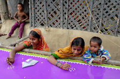 Women Woker. Underprivileged women are doing stitching and embroidery to support their families in West Bengal-India. They earn a little money for fulfill their Stock Photography