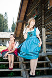 Women by a wooden Hut Royalty Free Stock Photography