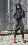 Women in wool jacket on a street. Women in grey wool jacket on a street. Sunlight stock images