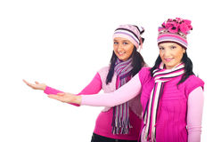 Women in woolen pink clothes making presentation Royalty Free Stock Photos