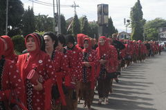 The women wore red beskap in carnival Stock Images