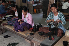 Women work in a factory of lacquerware Royalty Free Stock Images