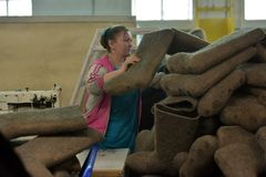 Women work in a felt boots factory Royalty Free Stock Images