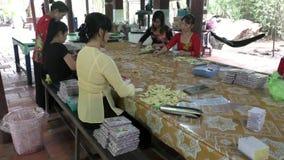 Women work and make coconut candies in Vietnam stock video footage