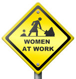 Women at work. Yellow diamond sign warning female working, busy and occupied, don't disturb,equality and emancipation,equal chances and opportunities Stock Photography
