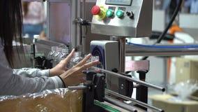 Women worker put the empty plastic bottle.