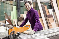 Women worker using saw machine to make furniture Royalty Free Stock Images