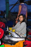 Women workers are collecting and sorting fisheries into baskets after a long day fishing in the Hon Ro seaport, Nha Trang city Royalty Free Stock Photos