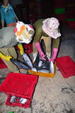 Women workers are collecting and sorting fisheries into baskets after a long day fishing in the Hon Ro seaport, Nha Trang city Stock Photos