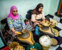 Women processing argan oil Stock Image