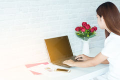 Women Working with a business. Modern woman Working with a business laptop in white office Royalty Free Stock Photo