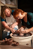 Women working with clay Stock Photos