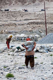 Women working hard in road-building in the Indian Himalayas Stock Photo