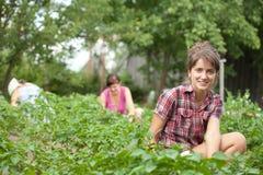 Women working in her  garden. Three women working in her vegetable garden Royalty Free Stock Photography