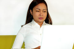Women working on laptop. Women working on computer at home stock image