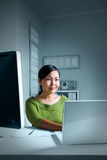 Women working late night. At the office Royalty Free Stock Photo