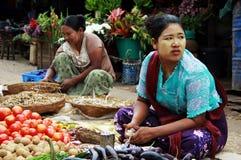 Women working in a market in Myanmar Stock Image