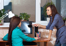 Women working in office. Two women using computer in office Royalty Free Stock Photos