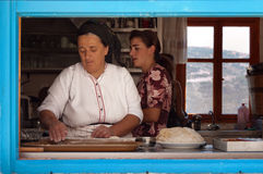 Women working in Olympos, Karpathos island, Greece. Royalty Free Stock Images