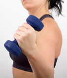 Women working out. Women working with blue dumbell stock image