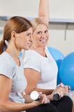 Women working out in gym Stock Images