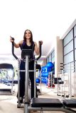 Women working out on spinning bikes Royalty Free Stock Photos