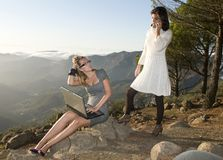 Women working with portable laptop in the mountain Stock Photos