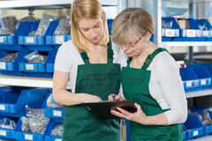 Women working in storehouse Royalty Free Stock Images