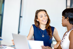 Women working together, office interior Royalty Free Stock Images