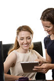 Women working together Stock Image