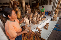 Women working in the woodcarver workshop Royalty Free Stock Image