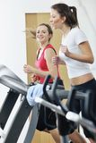 Women workout  in fitness club on running track Stock Photos