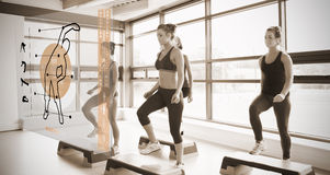 Women workout with orange interface showing them how to do Royalty Free Stock Photos