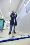 Women at workplace, female cleaner sweeping floor Royalty Free Stock Photos